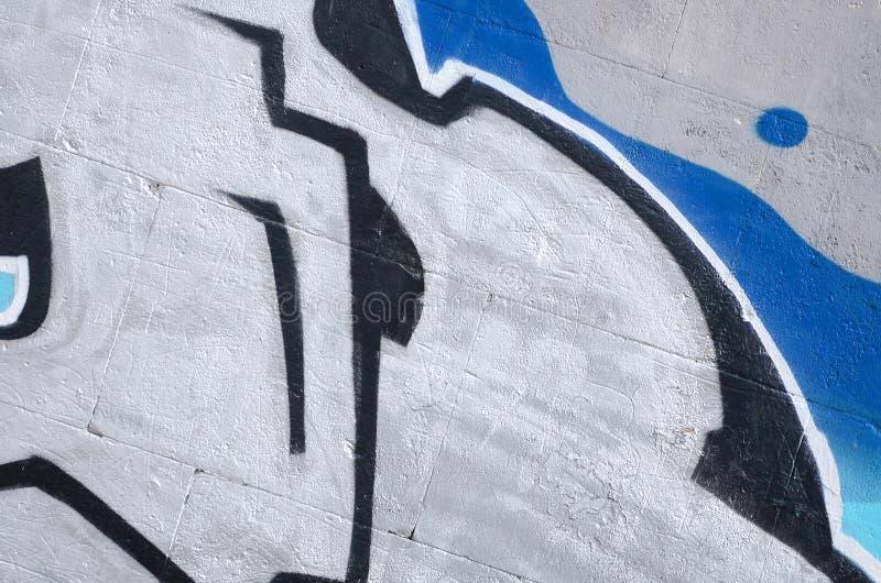 Fragment van gekleurde de graffitischilderijen van de straatkunst met contouren en dicht omhoog het in de schaduw stellen stock afbeeldingen
