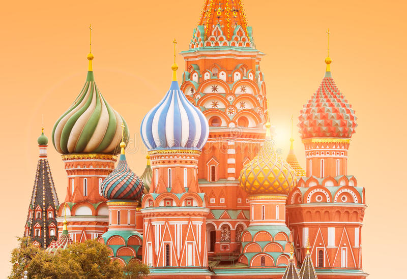 Fragment view of Saint Basil`s Cathedral. In Moscow with sun on the background royalty free stock image