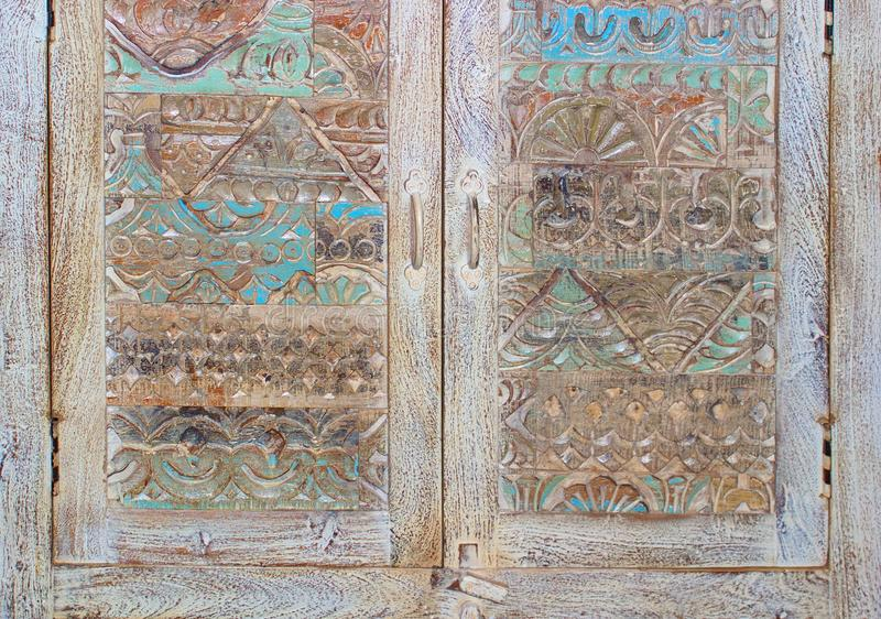 Fragment vintage antique carved doors East of the chest stock photos