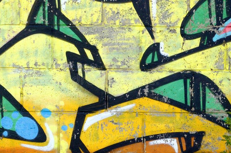 Fragment von farbigen Stra?enkunst-Graffitimalereien mit Konturen und oben schattieren Abschluss stockfotos
