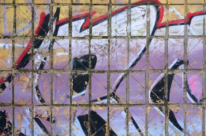Fragment von farbigen Stra?enkunst-Graffitimalereien mit Konturen und oben schattieren Abschluss stockfoto