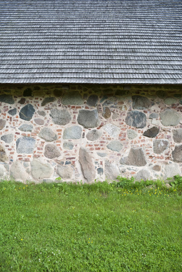 Fragment of the wall of the house put from big granite stones royalty free stock photos
