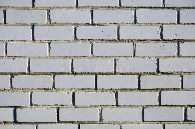 Fragment of a wall of white silicate brick royalty free stock image