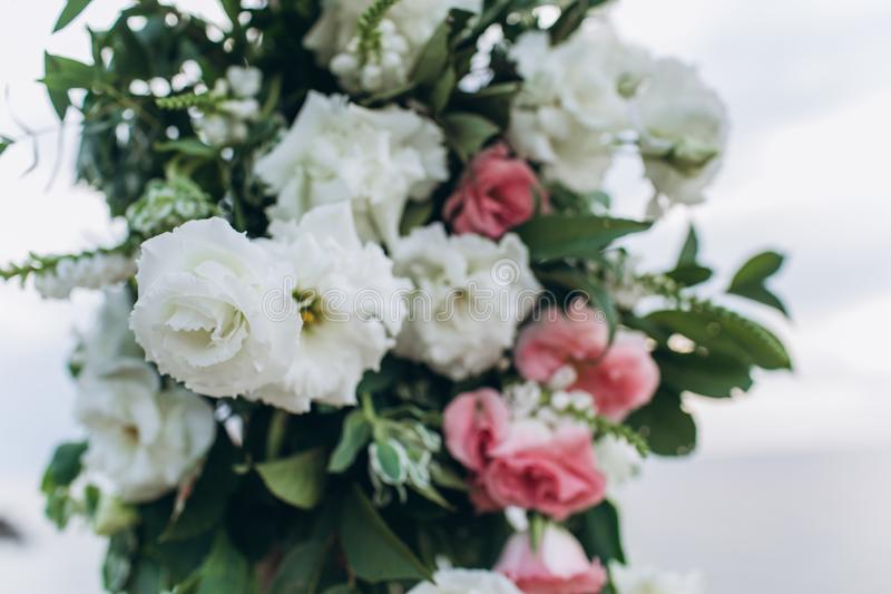 Fragment of a wedding arch for an exit ceremony decorated with white and pink flowers. royalty free stock images