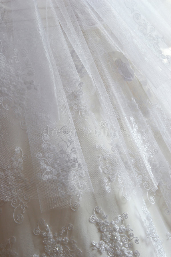 Fragment wedding dress beadwork and a silk tape. Embroidery on a white thin fabric beads stock image