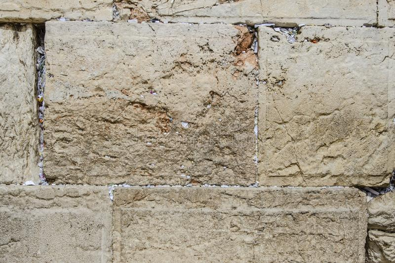 Fragment of Western Wall with sticky notes in Jerusalem Israel. Fragment of Western Wall with sticky notes in Old City of Jerusalem Israel royalty free stock image