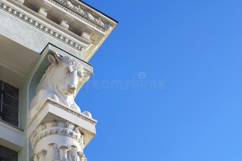 Column topped with cow or bull head supporting portico stock images