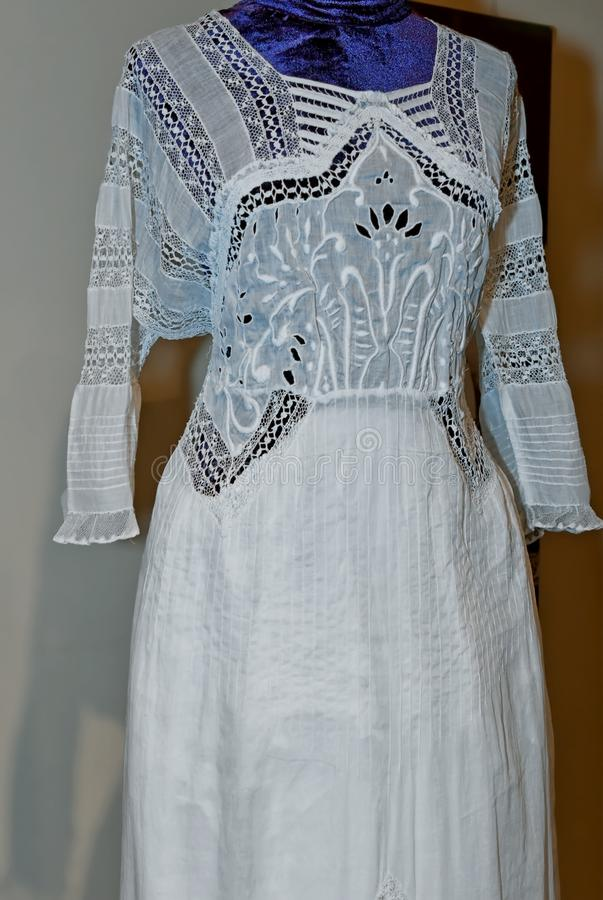 Fragment of a white lacy dress stock images
