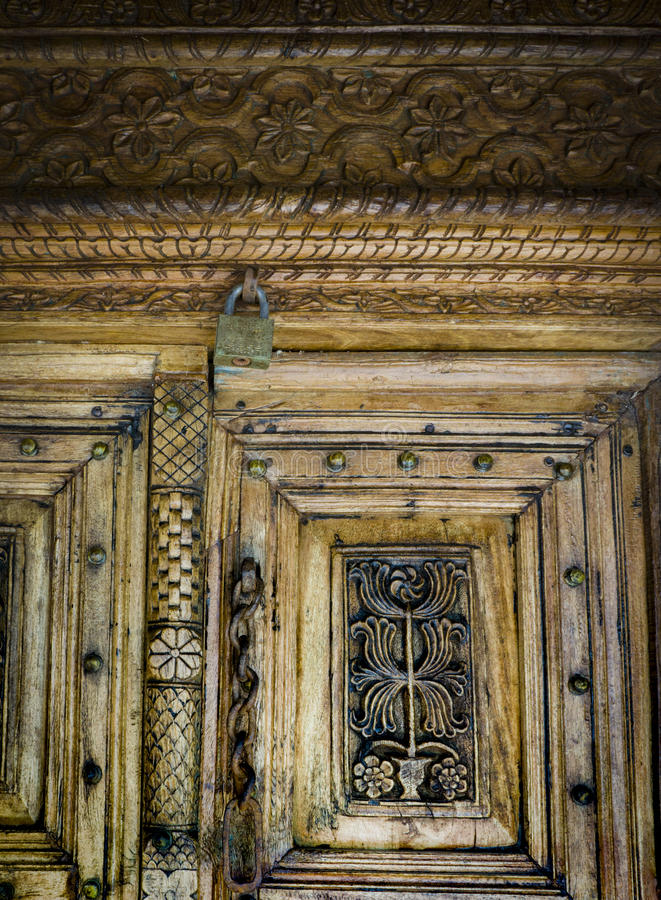 Fragment of wood carving on the door. royalty free stock image