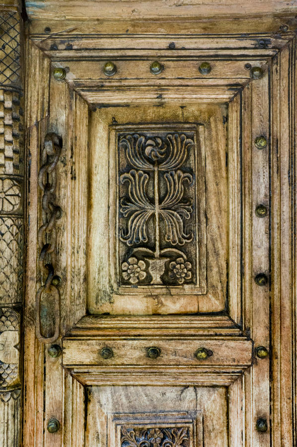 Fragment of wood carving on the door. stock photos