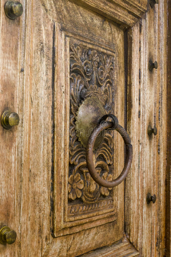 Fragment of wood carving on the door. royalty free stock photography