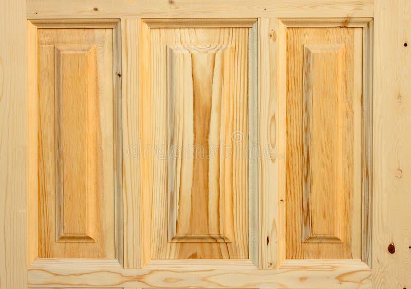 Fragment wooden door made of coniferous tree