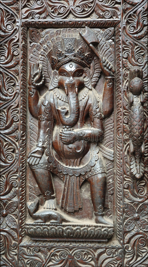 Fragment Of Wooden Nepalese Door With Ganesha Stock Photos