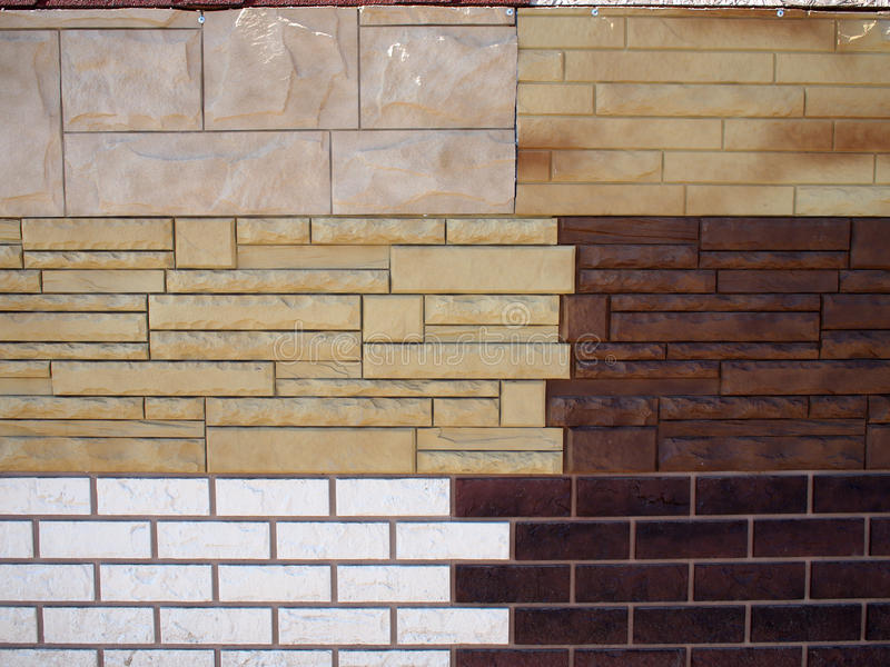 Fragmentmuur met verschillende types van decoratieve deklaag stock afbeeldingen