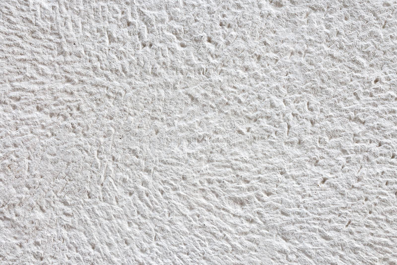 Fragmento da textura branca natural do fundo da superfície da pedra fotografia de stock