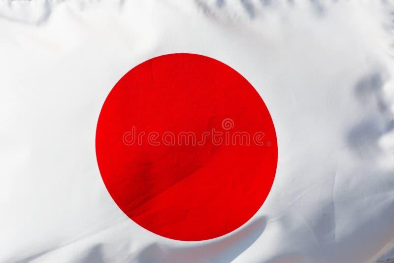 Fragmento de la bandera japonesa en la luz del sol fotografía de archivo