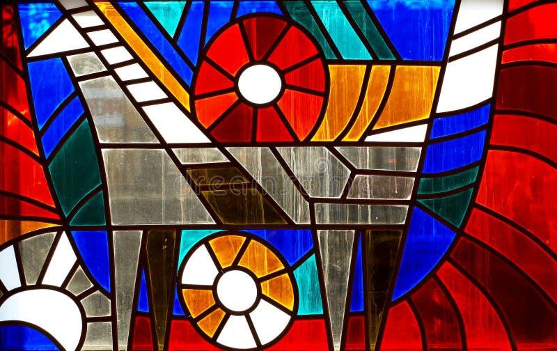 Fragmento de la ventana de cristal de colores fotografía de archivo