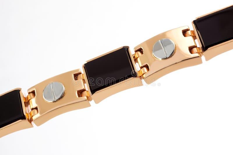 Fragmento de um bracelete maciço do ouro imagem de stock royalty free