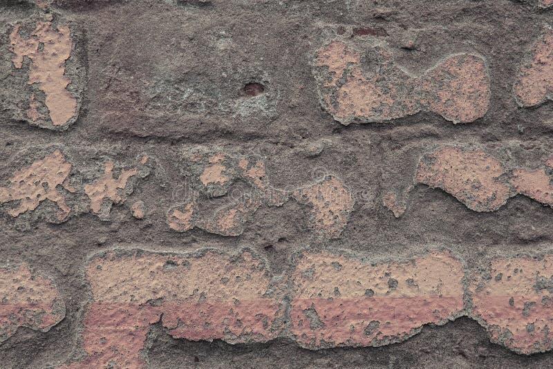 Fragmento de um fim velho da parede de tijolo acima Textura industrial ou do s?t?o do estilo imagens de stock royalty free
