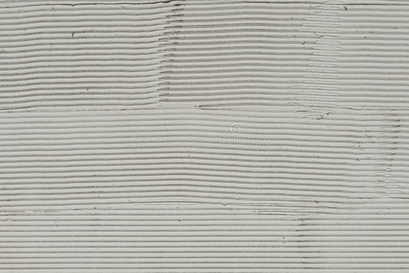 Fragmento de una pared con los rasguños y las grietas imagen de archivo libre de regalías