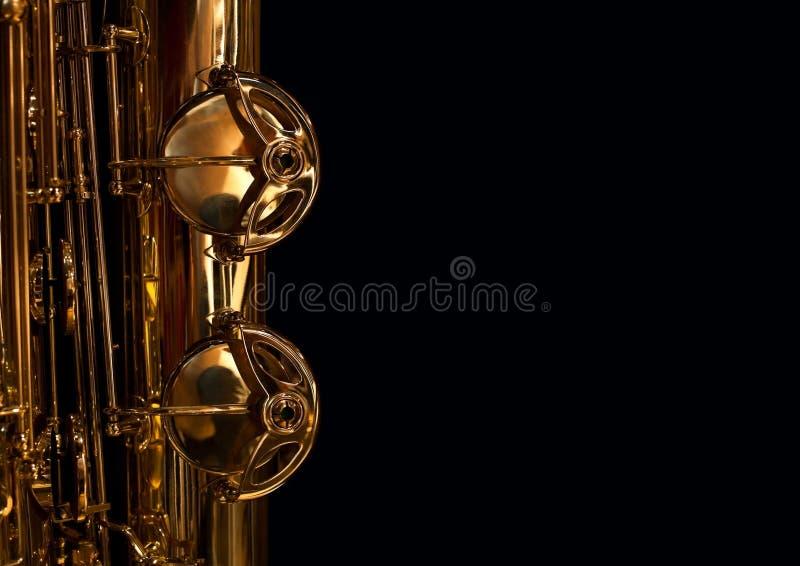 Fragmento de válvulas do saxofone fotografia de stock royalty free