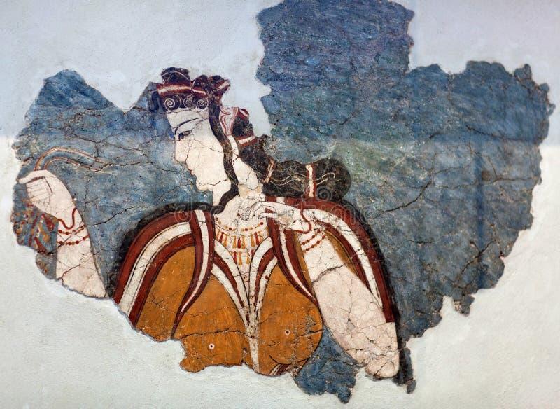 Fragmento Mycenaean da pintura de parede do fresco que descreve uma mulher de uma procissão cerimonial no palácio de Tiryns fotografia de stock