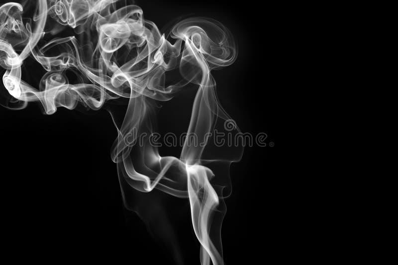 Fragmentos del humo fotografía de archivo