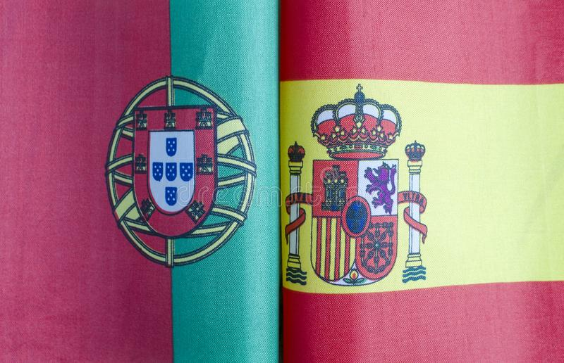 Fragments of flags of Portugal and Spain close-up stock photography