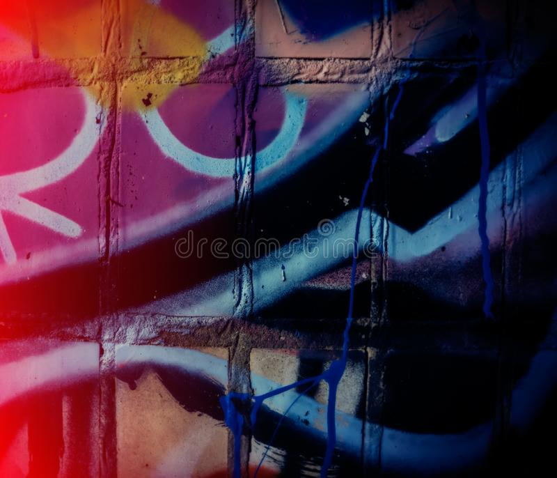 Fragments of Graffiti and Poured Paint on the Wall. Urban Modern Wallpaper. Bright Paint. Urban Environment. Blurred Background stock images