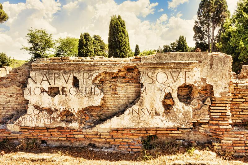Fragments of marble inscriptions placed on the attic of Porta Romana. In Ostia Antica - Rome - Italy stock images