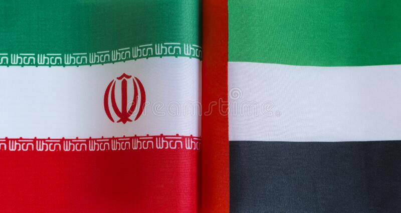 Fragments of national flags of Iran and the United Arab Emirates in close-up stock images
