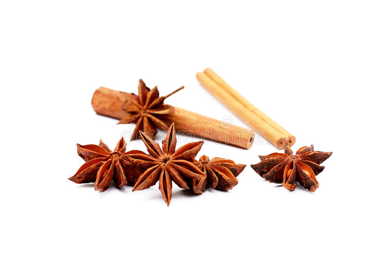 Fragrant anise and cinnamon. Isolated on white background royalty free stock photos
