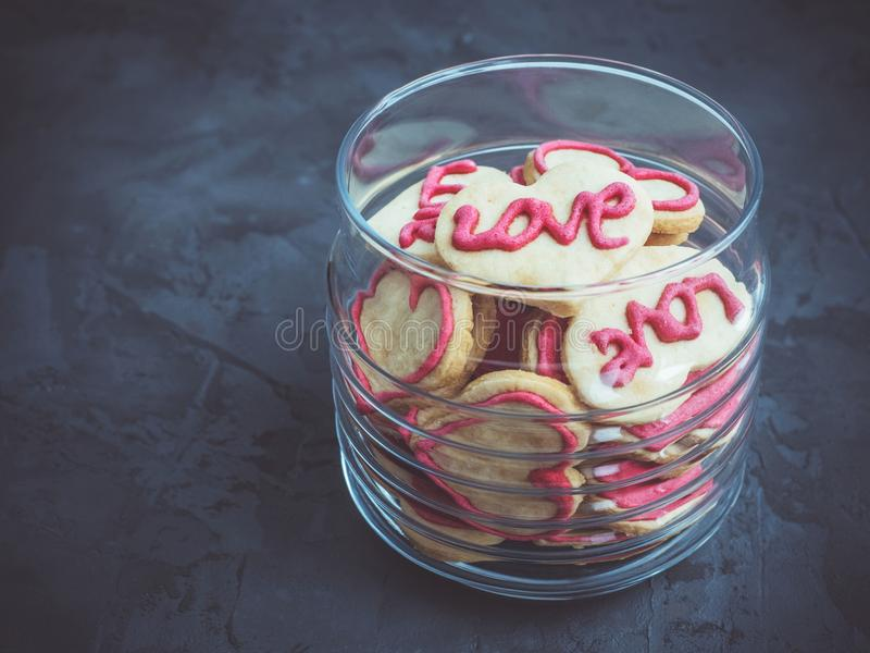 Fragrant cookies in the shape of a heart with the word love royalty free stock image