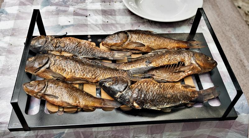 Finished smoked fish on the grill stock photography