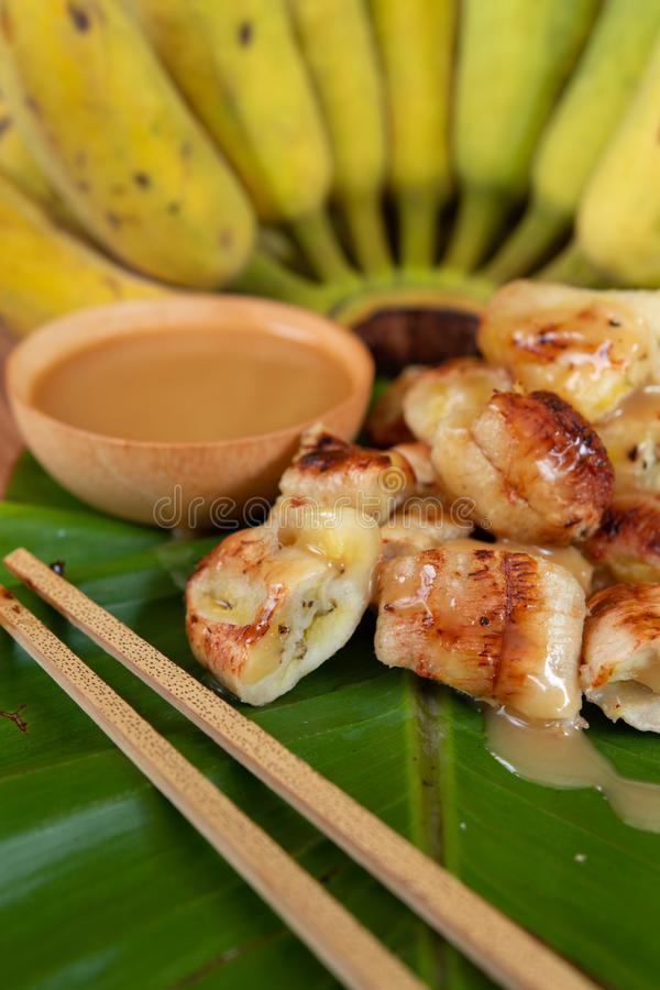 Grilled banana and coconut milk sauce. stock images