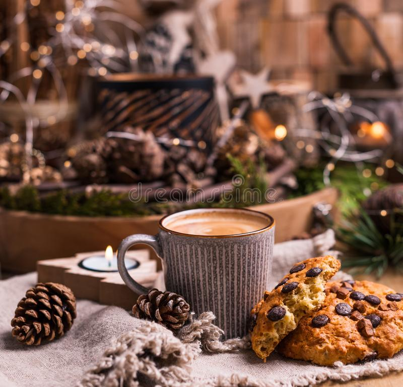 Fragrant hot coffee and chocolate cookies for Santa Claus. A drink for the holiday and a cozy Christmas atmosphere. Free space for royalty free stock photography