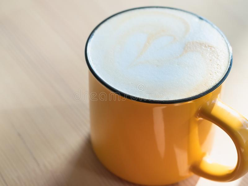 Fragrant morning  coffee mug with heart on foam on wooden table, close up, top view.  stock images