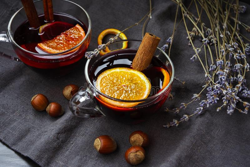 Fragrant mulled wine on a linen napkin with a bouquet of dry lavender royalty free stock photo