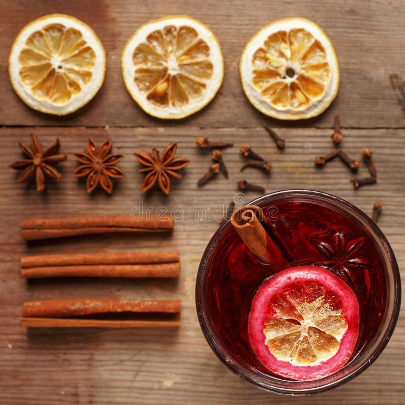 Fragrant mulled wine on a wooden table. Ingredients. Rustic royalty free stock photo