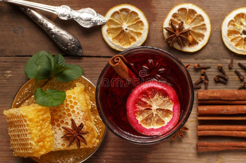Fragrant mulled wine on a wooden table. Ingredients. Rustic royalty free stock photography