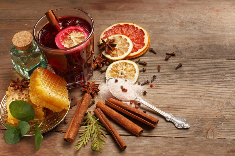 Fragrant mulled wine on a wooden table. Ingredients. Rustic stock photography