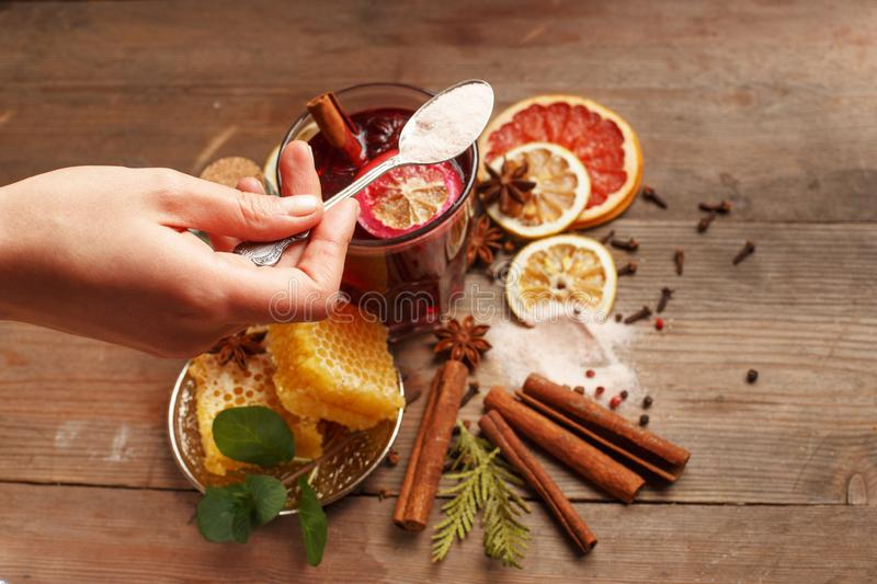 Fragrant mulled wine on a wooden table. Ingredients. Rustic stock photo