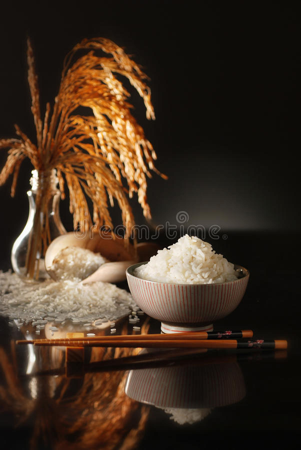 Fragrant Rice. A bowl of fragrant rice with dark background stock photos