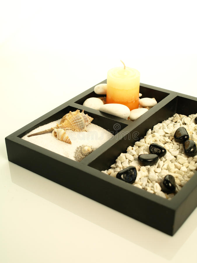 Fragrant spa candle on a decorated plate royalty free stock photography