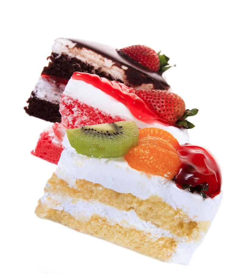 Fraise, chocolat, kiwi et gâteau orange de fruit d'isolement photo libre de droits