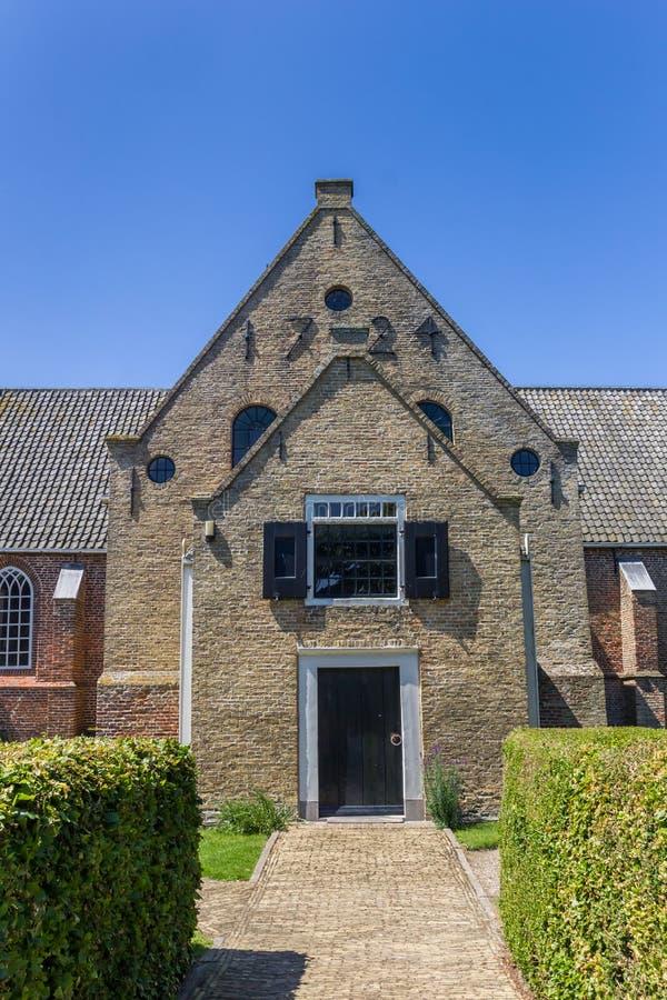 Framdel av den Maartenskerk kyrkan i Oosterend arkivfoton