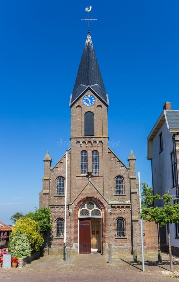 Framdel av den Martinus kyrkan i Oudeschild arkivfoton