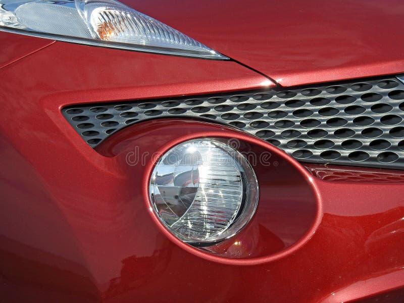Framdel för detalj för billyktor för Nissan jukebil arkivbilder