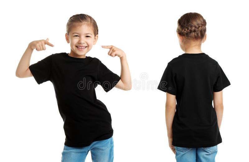Framdel- och baksidasikter av lilla flickan i svart t-skjorta fotografering för bildbyråer