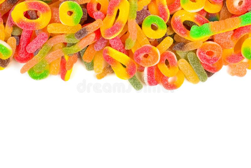 Frame of assorted gummy candies isolated on white. Top view. Space for text or design stock photo